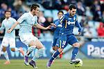 Getafe's Victor Rodriguez (r) and Celta de Vigo's Nemanja Radoja during La Liga match. February 27,2016. (ALTERPHOTOS/Acero)