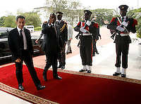 Ivorian president Alassane Ouattara(R) with former French president Nicolas Sarkozy(L) walks at the presidential palace in Abidjan, on March 18, 2016.