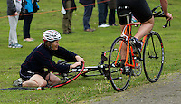 10 MAY 2015 - ST. NEOTS, GBR - A competitor repairs a puncture only a few metres from the exit of transition as she starts the bike leg of the 2015 British Sprint Triathlon Championships at Riverside Park in St. Neots, Great Britain (PHOTO COPYRIGHT © 2015 NIGEL FARROW, ALL RIGHTS RESERVED)