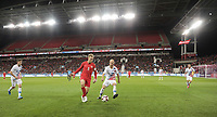 TORONTO, ON - OCTOBER 15: Scott Arfield #8 of Canada attempts to move past Michael Bradley #4 of the United States during a game between Canada and USMNT at BMO Field on October 15, 2019 in Toronto, Canada.