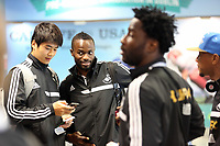 Wednesday 07 August 2013<br /> Pictured L-R: Ki Sung Yueng, Roland Lamah and Wilfried Bony at Cardiff Airport.<br /> Re: Swansea City FC travelling to Sweden for their Europa League 3rd Qualifying Round, Second Leg game against Malmo.