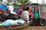 Women chat on a group of boats floating together on the Hau River in the Mekong Delta, south of Can Tho, Vietnam. Sept. 30, 2011.