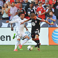 Perry Kitchen (23) of D.C. United goes against Diago Kobayashi (14) of the Vancouver Whitecaps FC. The Vancouver Whitecaps FC defeated D.C. United 1-0, at RFK Stadium, Saturday June 29 , 2013.