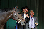 May 17, 2014. William Gowan, trainer of 2nd-place finisher Ride On Curlin (left), pauses while walking his colt after the race for a photo with Art Sherman, trainer of California Chrome, who won the 139th Preakness Stakes at Pimlico Race Course in Baltimore, MD. ©Joan Fairman Kanes/ESW/CSM