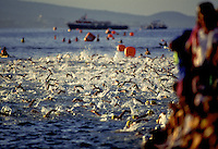 Swimmers compete in the rigorous 2.4 mile swim during the annual Ironman triathlon at Kailua Kona on the Big Island of Hawaii.