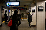Subway riders practice social distancing in New York, U.S., on Thursday, March 19, 2020. New York state Governor Andrew Cuomo on Thursday ordered businesses to keep 75% of their workforce home as the number of coronavirus cases rises rapidly. Photograph by Michael Nagle/Redux