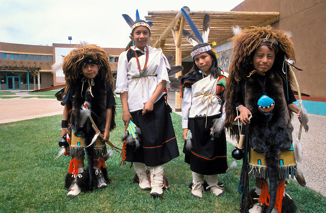 Children from the Santa Clara Pueblo dressed in traditional dance regalia and clothing, New Mexico