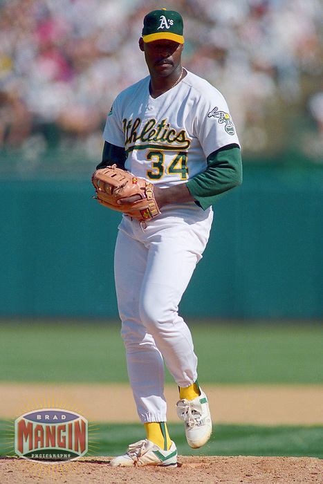 OAKLAND, CA - Dave Stewart of the Oakland Athletics pitches during Game 5 of the American League Championship Series against the Toronto Blue Jays at the Oakland Coliseum in Oakland, California in 1992. Photo by Brad Mangin