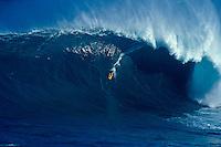 Mark Healy goes backside at Jaws, Maui.