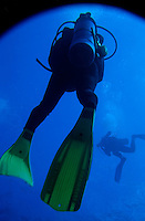 Two scuba divers swimming around Cathedral Dive Spot, Pango Point, Efate Island, Vanuatu.