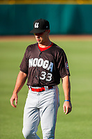 Chattanooga Lookouts left fielder TJ Hopkins (33) warms up prior to the game against the Tennessee Smokies at Smokies Stadium on June 18, 2021, in Kodak, Tennessee. (Danny Parker/Four Seam Images)