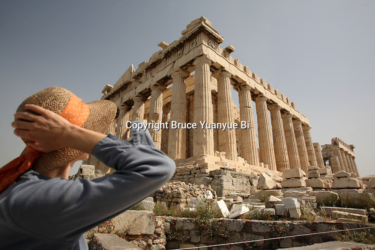 A visitor in front of Parthenon on Acropolis. Athens. Greece