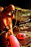 "After working for 24 hours straight, a crewman onboard the fishing vessel ""Maverick"" rests his eyes as he awaits the signal to throw the buoy and dump the crab pot overboard during King Crab crab fishing season in the Bering Sea in November 1993.  The Bering Sea is known for having the worst storms in the world.  Nights are long and cold in the arctic in the winter.  Crab fishing in the Bering Sea is considered to be one of the most dangerous jobs in the world.  This fishery is managed by the Alaska Department of Fish and Game and is a sustainable fishery.  The Discovery Channel produced a TV series called ""The Deadliest Catch"" which popularized this fishery."