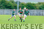 Oisin Maunsell of St Brendans breaks forward despite the attention from Mid Kerrys Diarmuid McGillicuddy in the Minor Football Championship quarter final.