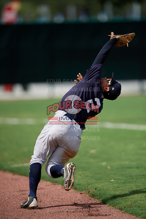 GCL Yankees West third baseman Luis Santos (2) tracks a pop up during the second game of a doubleheader against the GCL Braves on July 30, 2018 at Champion Stadium in Kissimmee, Florida.  GCL Braves defeated GCL Yankees West 5-4.  (Mike Janes/Four Seam Images)