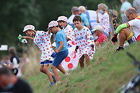 15th September 2020; Lyon, France; Tour De France 2020, La Tour-du-Pin to Villard-de-Lans, stage 16; Kids in polka dot cycling shirts looking for goodies in the grass