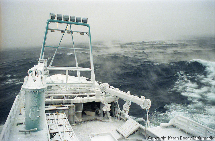 """Ice fog accompanies the fishing vessel """"Kiska Sea"""" as it fishes for opilio crab in the Bering Sea in January and February of 1995.  The Bering Sea is known for having the worst storms in the world. Ice fog is formed when the air is colder than the water. The boat is covered in ice from sea spray coming over the sides.  Crab fishing in the Bering Sea is considered to be one of the most dangerous jobs in the world.  This fishery is managed by the Alaska Department of Fish and Game and is a sustainable fishery.  The Discovery Channel produced a TV series called """"The Deadliest Catch"""" which popularized this fishery. Today this fishery, largely based out of Dutch Harbor, AK has been consolidated resulting in a lot less boats fishing."""