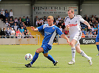 Pictured L-R: Kye Edwards of Port Talbot closely marked by Craig Beattie of Swansea. Saturday 17 July 2011<br />