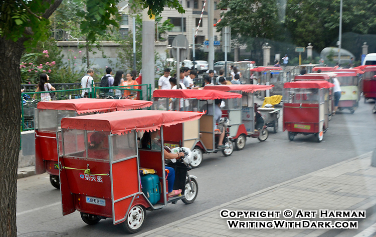 """""""Beijing Taxis"""" by Art Harman. Beijing is a city full of auto taxis, scooters, and these 'old-school' taxis. I rode in an open version like these."""