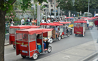 """Beijing Taxis"" by Art Harman. Beijing is a city full of auto taxis, scooters, and these 'old-school' taxis. I rode in an open version like these."