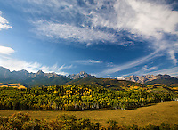 I spent an enjoyable, if cold, morning watching the sun rise and illuminate the distinctive figure of Mt. Sneffels and surrounding landscape.  Forest fires contributed to the haze in this image.<br /> <br /> Canon EOS 5D, 24-105 L lens.