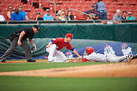 Buffalo Bisons third baseman Matt Dominguez (3) tags out Scott Schebler (12) sliding into third as umpire Jeremy Riggs looks on to make the call during a game against the Louisville Bats on June 20, 2016 at Coca-Cola Field in Buffalo, New York.  Louisville defeated Buffalo 4-1.  (Mike Janes/Four Seam Images)