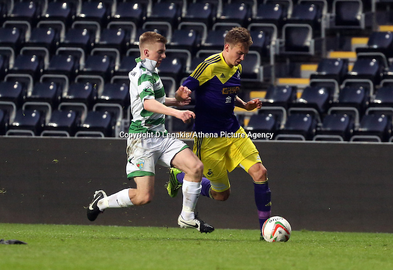 Thursday, 16 April 2014<br /> Pictured: Ryan Hedges of Swansea (R) against a TNS player.<br /> Re: FAW Youth Cup Final, Swansea City FC v The New Saints FC at the Liberty Stadium, south Wales,