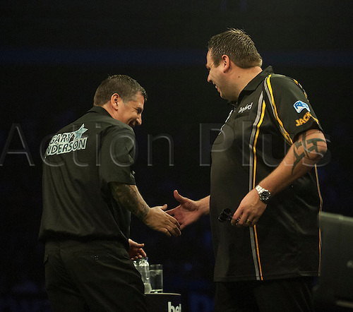 14.05.2015. Brighton, England. Betway Premier League Darts. Matchday 15.  Adrian Lewis [ENG] shakes hands with Gary Anderson [SCO] before their match.