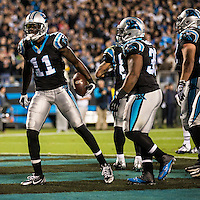 The Carolina Panthers play the New England Patriots at Bank of America Stadium in Charlotte North Carolina on Monday Night Football.  The Panthers defeated the Patriots 24-20.  Carolina Panthers wide receiver Brandon LaFell (11), Carolina Panthers fullback Mike Tolbert (35) celebrate the Panthers first touchdown.