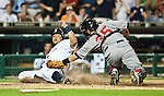 12 June 2010: Detroit Tigers first baseman Miguel Cabrera, left, dodges the tag from Pittsburgh Pirates catcher Jason Jaramillo (35) to score at home plate, in a Major League Baseball game between the Detroit Tigers and Pittsburgh Pirates at Comerica Park in Detroit, MI. The Tigers won 4-3 in extra innings.