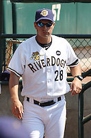 Manager Greg Colbrunn of the Charleston RiverDogs in the dugout during a game against the West Virginia Power on April 14, 2010  in Charleston, SC.