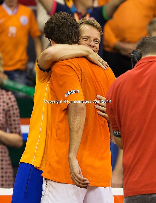 September 14, 2014, Netherlands, Amsterdam, Ziggo Dome, Davis Cup Netherlands-Croatia, Robin Haase  NED)is embraced by captain Jan Siemerink<br /> Photo: Tennisimages/Henk Koster