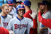 Buffalo Bisons catcher A.J. Jimenez (41) in the dugout after hitting a solo home run during the first game of a doubleheader against the Rochester Red Wings on July 6, 2014 at Frontier Field in Rochester, New  York.  Rochester defeated Buffalo 6-1.  (Mike Janes/Four Seam Images)
