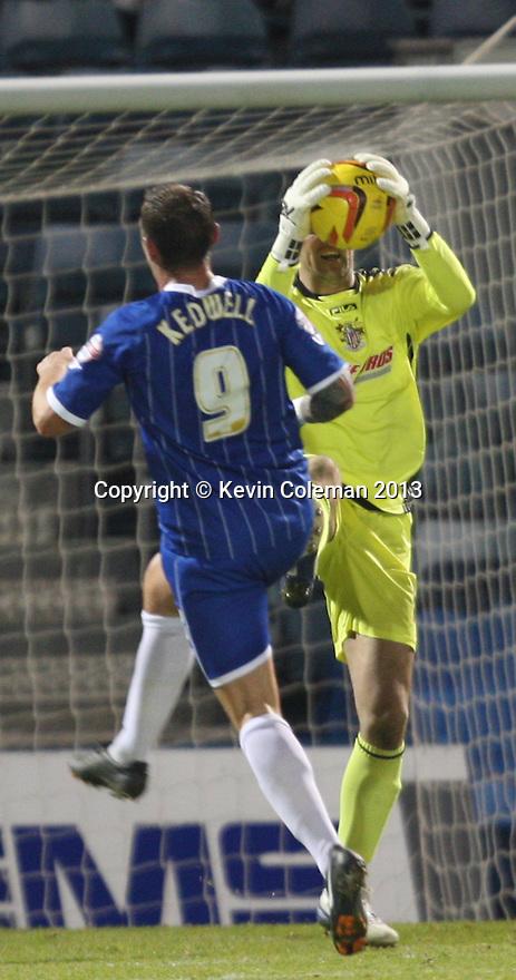 Chris Day of Stevenage gathers under pressure from Danny Kedwell of Gillingham<br />  - Gillingham v Stevenage - Sky Bet League One - Priestfield, Gillingham - 26th November 2013. <br /> © Kevin Coleman 2013