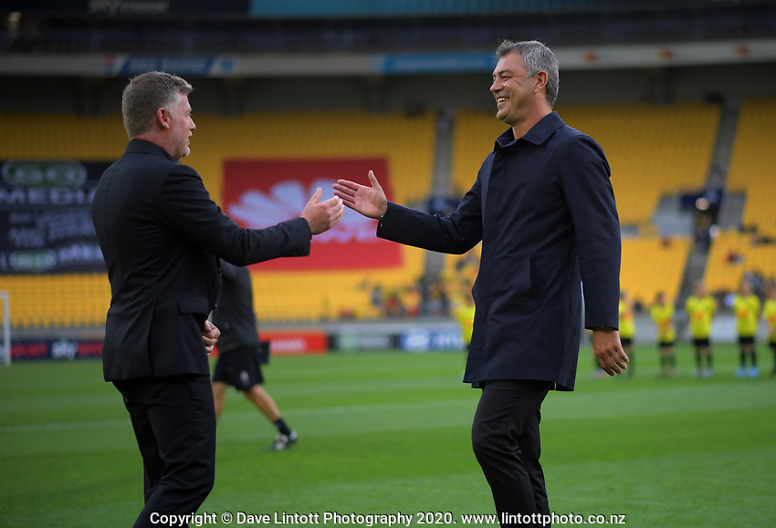 Coaches Uful Talay (left) and Mark Rudan catch up before kickoff during the A-League football match between Wellington Phoenix and Western United FC at Sky Stadium in Wellington, New Zealand on Friday, 21 February 2020. Photo: Dave Lintott / lintottphoto.co.nz