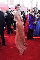 Charlize Theron  arrives, Sunday, during the 72nd Academy Awards at the Shrine Auditorium in Los Angeles.