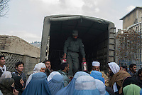 An aid delivery of cooking oil arrives at the Stadium refugee camp in Kabul. 23-1-14