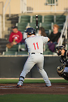 Michael Chavis (11) of the Greenville Drive at bat against the Kannapolis Intimidators at CMC-Northeast Stadium on April 28, 2015 in Kannapolis, North Carolina.  The Intimidators defeated the drive 3-2.  (Brian Westerholt/Four Seam Images)