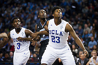 BROOKLYN, NY - Saturday December 19, 2015: Aaron Holiday (#3) of UCLA, Theo Pinson (#1) of North Carolina, and Tony Parker (#23) of UCLA watch in anticipation for a rebound as the two teams square off in the CBS Classic at Barclays Center in Brooklyn, NY.