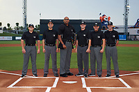 Umpires (L-R) Greg Roemer, Reid Joyner, Jose Navas, Derek Thomas, J.C. Velez, and Sean Shafer-Markle pose for a photo at home plate before the Florida State League All-Star Game on June 17, 2017 at Joker Marchant Stadium in Lakeland, Florida.  FSL North All-Stars  defeated the FSL South All-Stars  5-2.  (Mike Janes/Four Seam Images)