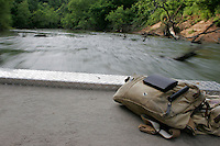 Filson Fore and Aft Pack on the deck of a cruising jetboat