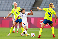 TOKYO, JAPAN - JULY 21: Tobin Heath #7 of the United States challenges for the ball during a game between Sweden and USWNT at Tokyo Stadium on July 21, 2021 in Tokyo, Japan.