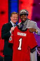 The seventh overall pick defensive back Mark Baron (Alabama) with NFL commissioner Roger Goodell during the first round of the 2012 NFL Draft at Radio City Music Hall in New York, NY, on April 26, 2012.