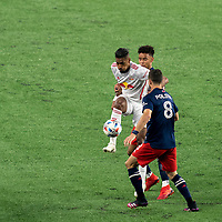 FOXBOROUGH, MA - MAY 22: Fabio Gomes #9 of New York Red Bulls attempts to control the ball as Brando Bye #15 of New England Revolution defends during a game between New York Red Bulls and New England Revolution at Gillette Stadium on May 22, 2021 in Foxborough, Massachusetts.