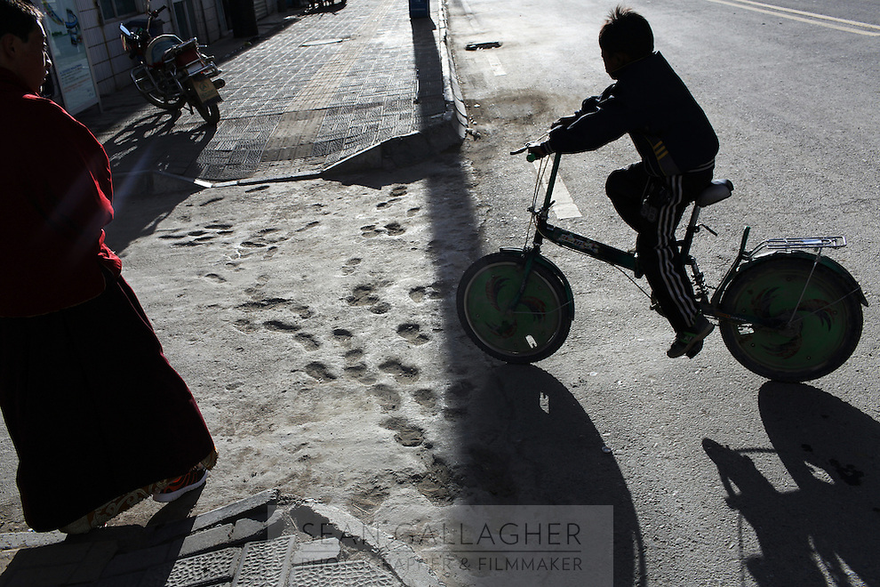 A child rides his bike in a town on the Tibetan Plateau, in western China.