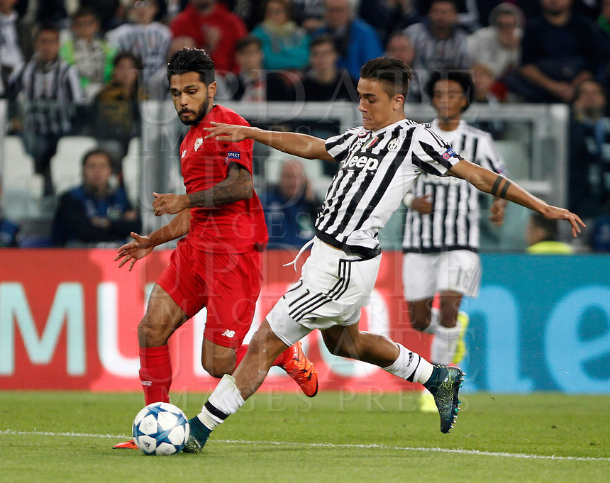 Calcio, Champions League: Gruppo D - Juventus vs Siviglia. Torino, Juventus Stadium, 30 settembre 2015. <br /> Juventus' Paulo Dybala, right, is challenged by Sevilla's Benoit Tremoulinas during the Group D Champions League football match between Juventus and Sevilla at Turin's Juventus Stadium, 30 September 2015. <br /> UPDATE IMAGES PRESS/Isabella Bonotto