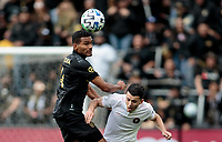 LOS ANGELES, CA - MARCH 01: Eddie Segura #4 of the LAFC heads a ball during a game between Inter Miami CF and Los Angeles FC at Banc of California Stadium on March 01, 2020 in Los Angeles, California.