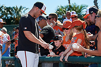 Baltimore Orioles pitcher Dylan Bundy (37) signs autographs for fans before a Grapefruit League Spring Training game against the Detroit Tigers on March 3, 2019 at Ed Smith Stadium in Sarasota, Florida.  Baltimore defeated Detroit 7-5.  (Mike Janes/Four Seam Images)