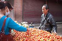 A street vendor sells vegetables in Kathmandu, Nepal.