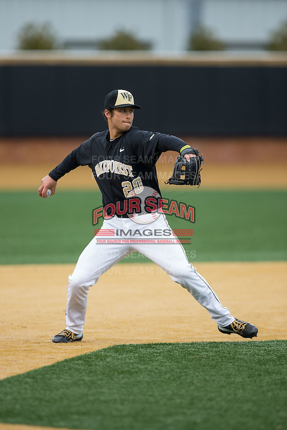 Wake Forest Demon Deacons third baseman Justin Yurchak (20) makes a throw to first base between innings of the game against the Appalachian State Mountaineers at Wake Forest Baseball Park on February 13, 2015 in Winston-Salem, North Carolina.  The Mountaineers defeated the Demon Deacons 10-1.  (Brian Westerholt/Four Seam Images)